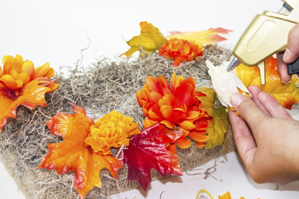 fall table display gluing corn