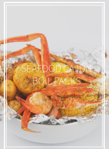 a white bowl of seafood, corn, potatoes, sausage and lemon in foil for seafood cajun boil packs