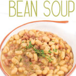 a bowl of ham and white bean soup with thyme and title