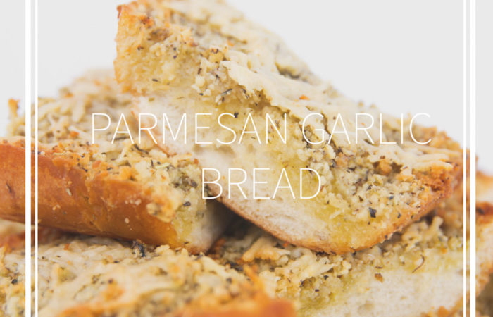 white plate of cooked sliced paremsan garlic bread