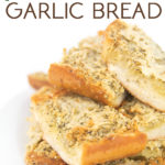 white plate of cooked sliced paremsan garlic bread with title