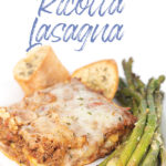 white plate of a piece of no ricotta lasagna with asparagus and toasted bread
