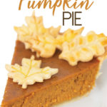 a piece of pumpkin pie on a white plate with leaf cut outs of crust