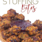 mini muffins with sausage, cranberries and stuffing with parsley on a wood cutting board with a bowl of cranberry sauce