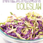 a glass bowl of green and red cabbage shredded for Mexican coleslaw with title