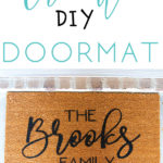 brown doormat with custom name painted on with title