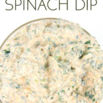 overhead shot of a glass bowl with spicy ranch spinach dip in it