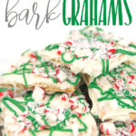 a white plate with white chocolate graham crackers with green drizzle and peppermints