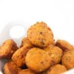 white bowl of mini muffins of chiptole pepper jack cornbreads