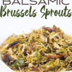 a white bowl of cooked shaved brussels sprouts with bacon and almonds