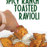 plate of air fried toasted spicy ranch ravioli with one dipping in ranch dressing