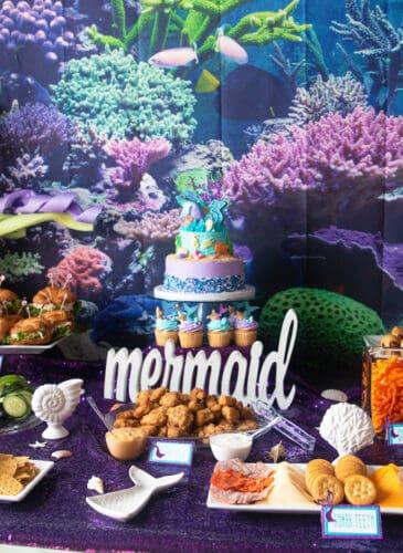 table spread of a mermaid/under the sea theme for a mermaid themed birthday