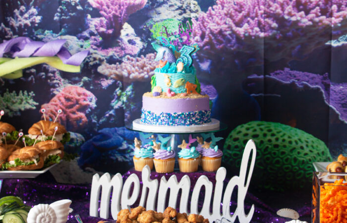 table spread of a mermaid/under the sea theme for a mermaid themed birthday